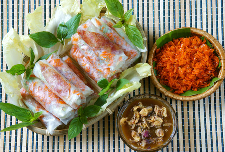 vietnamese food: Vietnamese food, bo bia is street food, snack that delicious, cholesterol free, make from dried small shrimp, vegetables, sausage, peanut in rice paper roll, sauce, Bobia is popular snack in Vietnam