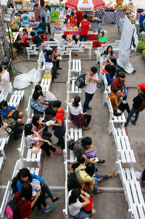 sale off: HO CHI MINH CITY, VIET NAM- DEC 20: Group of Asian young people join market day fair, sale off flea market for student in winter season,  lifestyle of Vietnamese people, Saigon, Vietnam, Dec 20, 2014