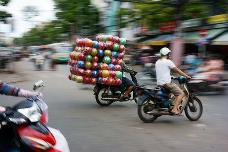 voluminous: HO CHI MINH, VIET NAM- MAR 30: Unsafe, danger of transportation on Vietnamese street, man ride motorcycle, transport goods in overloaded, voluminous, cause of traffic accident, Vietnam, Mar 30, 2013
