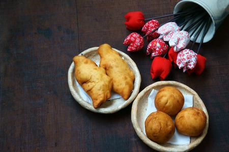 good cholesterol: Group of Vietnam street food: fried dumpling, quai vac cake, sponge cake make from wheat flour, good decoration on plate, wooden background, this Vietnamese snack is fastfood, rich cholestorol