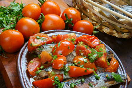 Vietnamese food, braised fish with tomato, a popular dish in Vietnam meal, cheap, tasty,  nutrition and fresh raw material,  fish stew with fish sauce, sugar season with tomato, spice