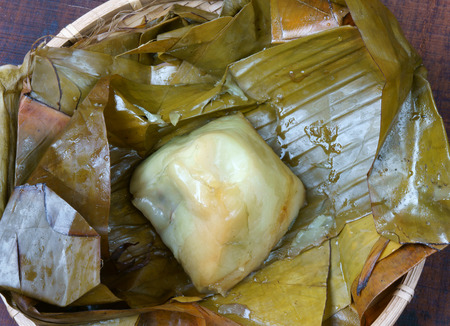 Vietnamese food, name Banh Gio: pyramid shaped rice dough dumpling filled with pork, shallot, andwood ear mushroomwrapped in banana leaf, is delicious street food, diet food make from rice flour