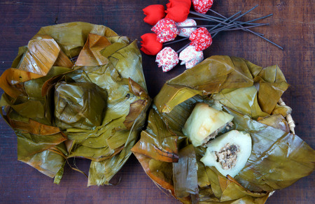 vietnamese food: Vietnamese food, name Banh Gio: pyramid shaped rice dough dumpling filled with pork, shallot, andwood ear mushroomwrapped in banana leaf, is delicious street food, diet food make from rice flour