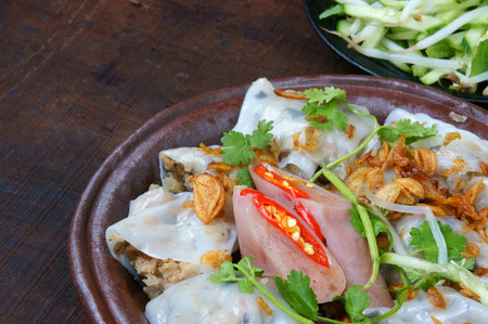 cuon: Vietnamese food, Banh Cuon name Rice noodle roll or rolled cake, is made from rice batter filled with mushroom, pork, served with Vietnam pork sausage, sliced cucumber,  bean sprouts and sauce