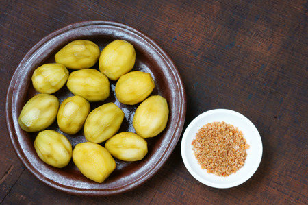 vietnamese food: Vietnamese food, delicious snack, from ambarella or Spondias mombin, soak in syrup about 2 days, eat with salt, it taste sour, sweet, brittle Stock Photo