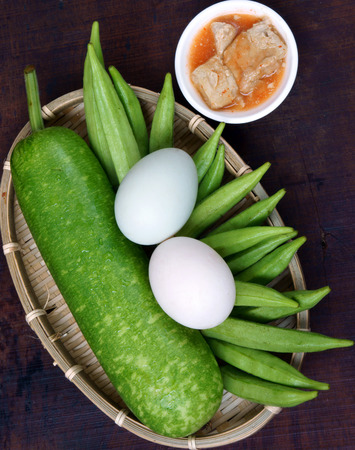 Meal for vegetarian with menu: bottle gourd, okra, egg, cooked rice, soya cheese. This Vietnamese food very delicious, nutrition, cholestorol free with organic, cheap ingredient and  for diet people Stock Photo
