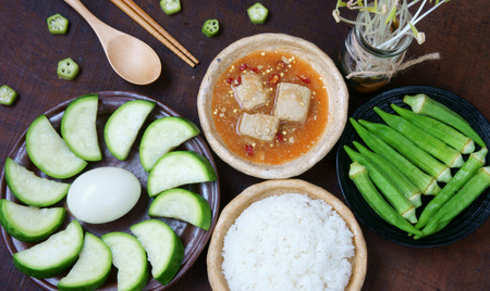 vietnamese food: Meal for vegetarian with menu: bottle gourd, okra, egg, cooked rice, soya cheese. This Vietnamese food very delicious, nutrition, cholestorol free with organic, cheap ingredient and  for diet people Stock Photo