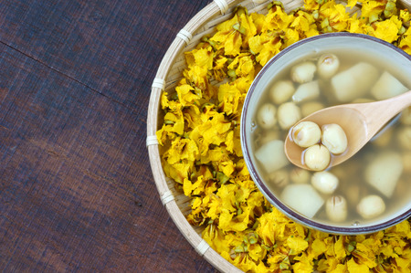 Vietnamese food, sweet lotus seed gruel, ingredients: lotus bean, mung bean, water chestnut and sugar candy. this Vietnam dish for dessert or snack, very delicious, tasty, nutrition, make sleep well Imagens