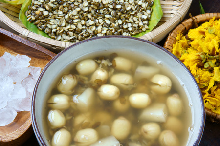 sleep well: Vietnamese food, sweet lotus seed gruel, ingredients: lotus bean, mung bean, water chestnut and sugar candy. this Vietnam dish for dessert or snack, very delicious, tasty, nutrition, make sleep well Stock Photo