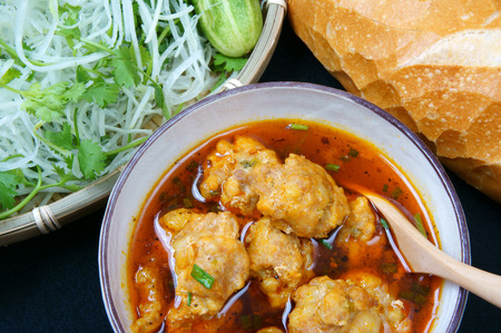 dalat: Vietnamese food, meatball, make from ground meat, delicious, popular street food or Vietnam meal, season with vegetable as: cucumber, scallion, papaya  and bread. This dish process by Dalat style Stock Photo