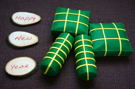 vietnamese food: Vietnamese food,  banh chung, banh tet are traditional eating on Tet holiday, wrap in green leaf. When spring come, on Vietnam Lunar New Year , people worship the ancestor with glutinous rice cake