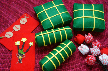 come in: Vietnamese food,  banh chung, banh tet are traditional eating on Tet holiday, wrap in green leaf. When spring come, on Vietnam Lunar New Year , people worship the ancestor with glutinous rice cake
