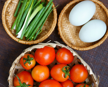 anti season: Vietnamese food, tomato saute egg, popular Vietnam food in Viet Nam meal, ingredient as egg, tomato, season with scallion, pepper, verry nutrition, cheap dish, for diet or vegeterian, anti cancer