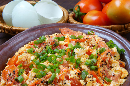 verry: Vietnamese food, tomato saute egg, popular Vietnam food in Viet Nam meal, ingredient as egg, tomato, season with scallion, pepper, verry nutrition, cheap dish, for diet or vegeterian, anti cancer