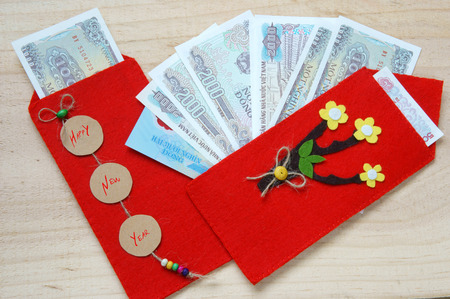 Habit, custom of Vietnamese on Tet is lucky money, a Vietnam traditional culture, child  wish somebody a happy new year, receive red envelope with new small change, Tet on spring, also lunar new year