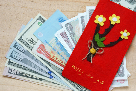 somebody: Habit, custom of Vietnamese on Tet is lucky money, a Vietnam traditional culture, child  wish somebody a happy new year, receive red envelope with new small change, Tet on spring, also lunar new year