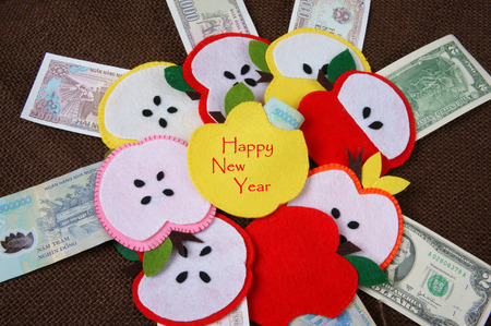 red envelope: Red background of Vietnam Tet, habit, custom of Vietnamese on Tet is lucky money, a Vietnam traditional culture, child  wish somebody a happy new year, receive red envelope, Tet  also lunar new year Stock Photo