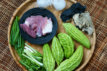 Vietnamese food, soup of bitter melon stuffed with ground meat, a nutrition, popular dish in Vietnam meal, bitter gourd rich vintamin, can anti diabetes, season with spring onion, peziza.