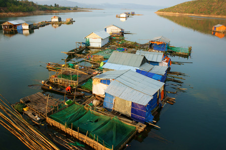buon: DAKLAK, VIET NAM- FEB 26: Asian residence on water,  group of floating house of fishing village, beautiful Vietnamese countryside, impression panoramic, Dak Lak, Vietnam, Feb 26, 2015