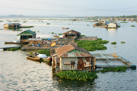 aquaculture: DONG NAI, VIET NAM- FEB 28: Life of Asian fisherman on La Nga river, group of floating house in residence of fishing village, people make living by aquaculture, river fish, Vietnam, Feb 28, 2015