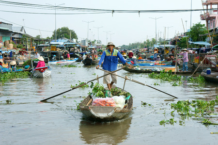 SOC TRANG, VIET NAM- MAR 23: Crowded atmosphere on Nga Nam floating market, group of rowing boat on river,panoramic of  trade activity on farmer market of Mekong Delta, Vietnam, Mar 23, 2015