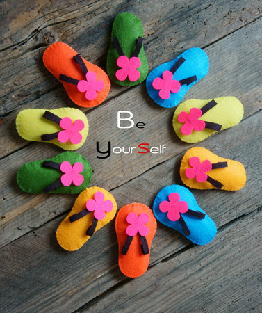 strong message: Be yourself, a message from abstract idea, group of handmade sandals in vibrant color, make from fabric, be strong, confident with your personality, an amazing concept Stock Photo