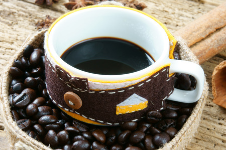 stimulate: Coffee background with coffee cup, coffee bean on wooden background, beautiful and amazing concept, cafe is drinking that rich caffeine, stimulate to sense, mind