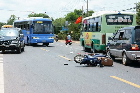 DONG NAI VIET NAM MAY 1: Traffic accident on highway 20 crowded of Vietnamese people on street car crash with motorbike crashed car motorcycle lay on street unsafe traffic Vietnam May 1 2015