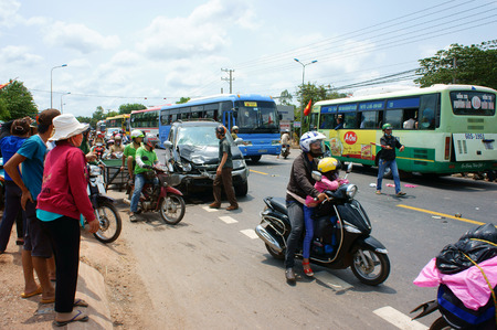 unsafe: DONG NAI VIET NAM MAY 1: Traffic accident on highway 20 crowded of Vietnamese people on street car crash with motorbike crashed car motorcycle lay on street unsafe traffic Vietnam May 1 2015