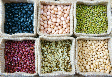 Collection of grain, green bean, red bean, soybean, black bean in bag, cereal product is healthy food, nutrition eating and fibre food