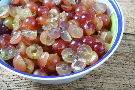 clean cut: Making grape wine at home from grape fruit and sugar, grapewine is delicious, nutrition, healthy drink, grape after clean, cut in half, embalm with sugar, a alcoholic fermentation to make wine