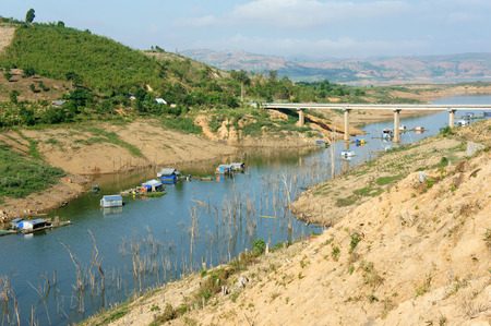ka: Vietnam countryside landscape impression chain of mountain cover Nam Ka lake bare hill from deforestation amazing scene with floating house on river residential on water Stock Photo