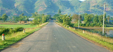 buon: Beautiful Vietnamese countryside landscape way forward chain of mountain in morning field along highway fresh environment eco green street like goal or target