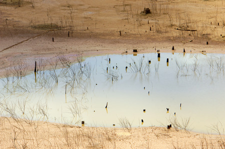 water source: Hot summer water source exhaustion bottom of lake became drought land water security is environment problem of global change climate make disaster Stock Photo