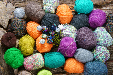 wymowny: Handmade gift for special day as mother day, father day, valentine day or wintertime, heap of ball of wool to knit colorful scarf for cold day, knitting to make meaningful present