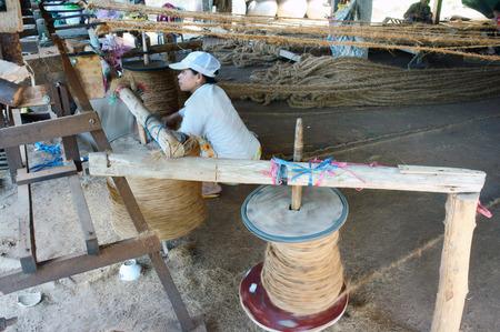 matting: BEN TRE, VIET NAM- JUNE 1: Asian worker work inside coir mat workshop, Vietnamese woman work traditional craft, coconut matting to export, coconut fiber material at Mekong Delta, Vietnam, June 1, 2015