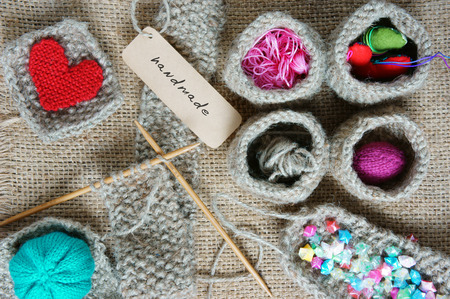 Handmade product from fibre, hand made basket make from knit, knitting heart, leisure with art hobby, lovely creatve Archivio Fotografico