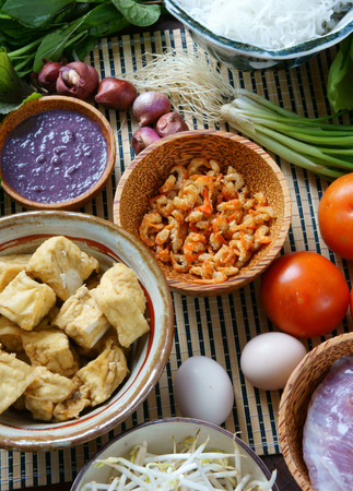 vietnamese food: Vietnamese food, bun rieu, a famous dish of Vietnam, raw material as tomato, crab, pork meat, shrimp, salad, scallion, egg, vegetable, shrimp paste, bunrieu is Viet Nam special eating