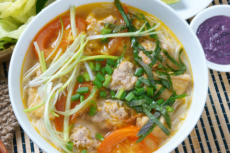 Vietnamese food, bun rieu, a famous dish of Vietnam, raw material as tomato, crab, pork meat, shrimp, salad, scallion, egg, vegetable, shrimp paste, bunrieu is Viet Nam special eating