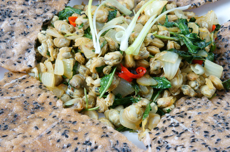 vietnamese food: Vietnamese food, mussel fry with rice paper, a speciality of Hue eating, a Vietnam snack, raw material as mussel, laksa leaves, chili, pepper, onion, spice, garlic