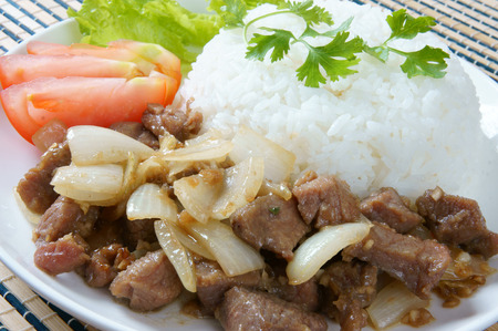 Vietnamese food, bo luc lac, nutrition and delicious eating, beef fry with spice, onion, garlic, eat with salad, tomato, cooked rice