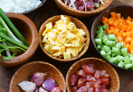 chien: Vietnamese food, fried rice, a delicious Asian eating, raw material as carrot, cooked rice, meat, egg, sausage, onion, garlic, this meal rich cholesterol, calories Stock Photo