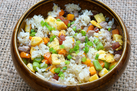 cooked rice: Vietnamese food, fried rice, a delicious Asian eating, raw material as carrot, cooked rice, meat, egg, sausage, onion, garlic, this meal rich cholesterol, calories Stock Photo