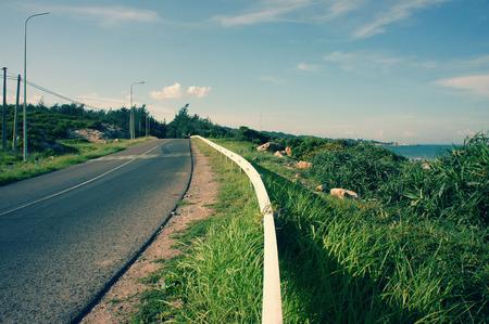 Beautiful scene of Viet Nam coastal, boundary among beach and road, wonderful landscape at Vietnamese countryside, shadow on street, this view at Lagi, Binh Thuan, VietNam