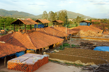 brickwork: BINH DINH, VIET NAM- AUG 22: Old brickwork at countryside Vietnamese, trade village to product brick, material for contruction, make from soil, burn by firewood, ecology problem, Vietnam, Aug 22, 2015