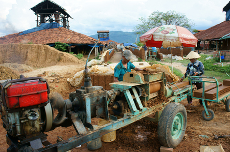 paredes de ladrillos: BINH DINH, VIET NAM- AUG 22: Old brickwork at countryside Vietnamese, trade village to product brick, material for contruction, make from soil, burn by firewood, ecology problem, Vietnam, Aug 22, 2015