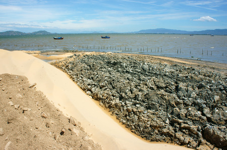 to fill up: Reclamation project at Quy Nhon, Binh Dinh, Viet Nam, fill up sand on water to make construction plan, try to change nature for human profit, fill soil at seaside