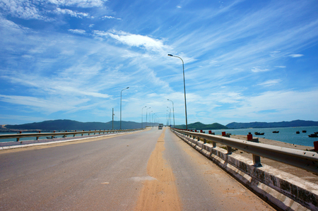 country landscape: Vietnamese country road, cross sand hill, jungle or mountain, route for travel, discovery Vietanam, landscape of rural under blue sky on day