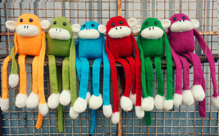 handmade: Amazing background of handmade product, group of homemade monkey with funny humorous in colorful, knitted monkeys make by knit from wool, woolen toy to happy new year 2016, so fun animal