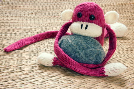 nice face: Amazing background of handmade product, group of homemade monkey with funny humorous in colorful, knitted monkeys make by knit from wool, woolen toy to happy new year 2016, so fun animal